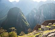Reconstructed housing in the morning sun at Machu Picchu, Cusco Region, Urubamba Province, Machupicchu District in Peru, South America