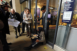 © Licensed to London News Pictures. 24/11/2011, London, UK. A Natwest employee asks protesters to stop banging the door. Protesters with a megaphone cause the closure of a branch of Natwest near to the camp. Occupy UK protest camp at St Paul's Cathedral today 24 November 2011. Photo credit : Stephen Simpson/LNP