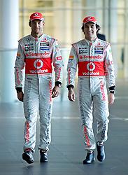 "© London News Pictures. 31/01/2013 . Woking, UK.  Team McLaren Mercedes drivers Jenson Button and Sergio ""Checo"" Perez unveil the new MP4-28 Formula 1 car at the McLaren Technology Centre in Woking, Surrey, UK on  Thursday, Jan. 31, 2013. Photo credit : Ben Cawthra/LNP"