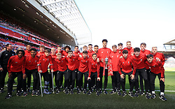 Liverpool U18's with their Youth Cup trophy at half time of the Premier League match at Anfield, Liverpool.