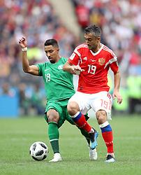 Saudi Arabia's Salem Al-Dawsari (left) and Russia's Aleksandr Samedov battle for the ball during the FIFA World Cup 2018, Group A match at the Luzhniki Stadium, Moscow.