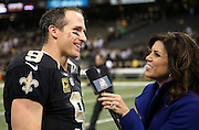 New Orleans Saints quarterback Drew Brees (9) smiles as he does a postgame television interview with NBC Sports sideline analyst Michele Tafoya after the NFL week 8 regular season football game against the Green Bay Packers on Sunday, Oct. 26, 2014 in New Orleans. The Saints won the game 44-23. ©Paul Anthony Spinelli