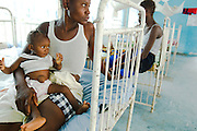 Saley Kelfa, 25, holds her seven-month-old daughter Sonja Kelfa, suffering from malnutrition, at the Bonthe district hospital in the town of Bonthe, Sierra Leone on Thursday April 22, 2010. Saley already has five children, she has lost a 6 month-old child in the past.