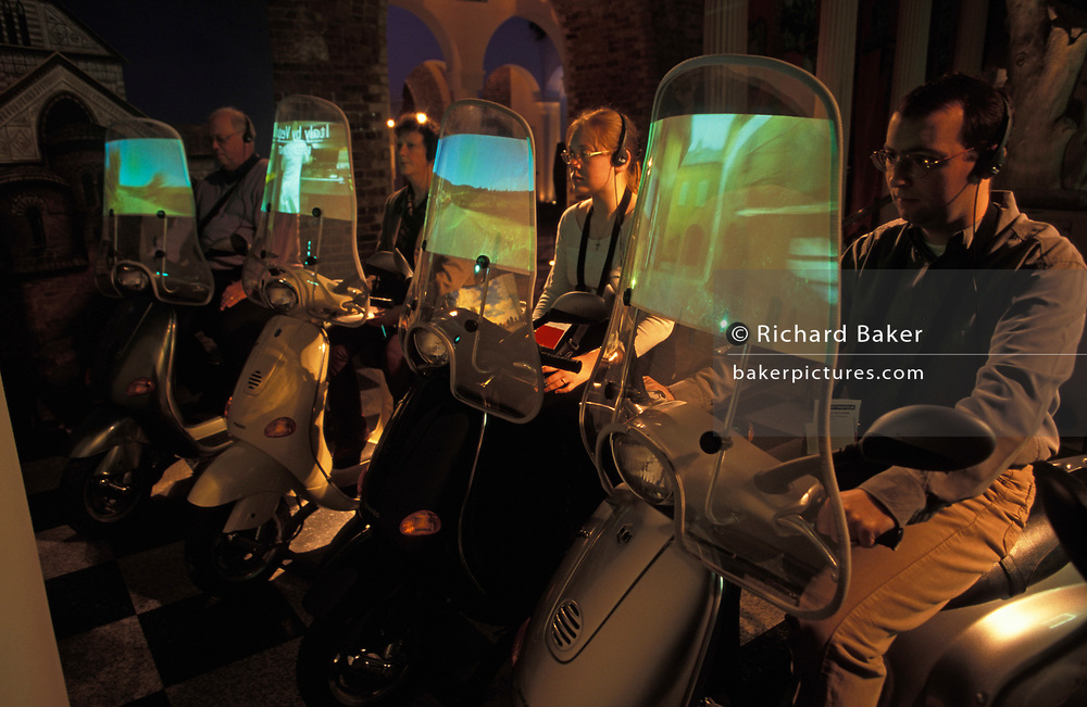 Visitors experience an interactive travel exhibit in The Millennium Dome (later to become the 02 Arena) weeks after the Millennium, on 14th January 2000, in London, England.