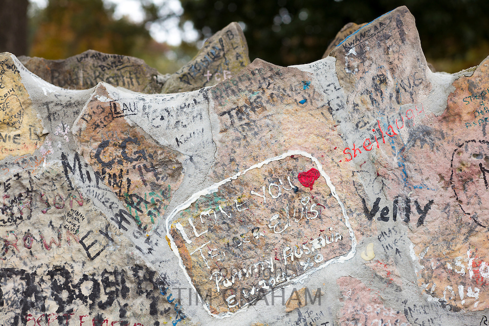 Love messages from adoring fans, graffiti on wall at Graceland, home of rock and roll star Elvis Presley, Memphis, Tennessee USA