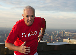 © Licensed to London News Pictures. 11/01/2012. LONDON, UK.  Channel 4 News anchorman and renowned journalist Jon Snow today officially launched Vertical Rush 2012, Shelter's tower-running endurance event, with a training race to the top of Tower 42 in the City of London...The event, now in its fourth year, challenges people to run up the 920 steps of the City of London's first skyscraper. The event raised over £200,000 last year, and in 2012 Shelter hopes to beat this total, as people test themselves to the limit to help raise vital funds for people in housing need.  Photo credit: Alison Baskerville/LNP