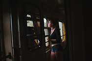 Tatiana, age 21, on the train from Mairupol to Kiev in Ukraine. From Poland, she had traveled to Mariupol to visit her grandparents and was now on her return to Poland. (September 27, 2015)