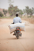 Transporting goods on the back of a moto in the north of Cameroon