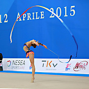 "Jerman Aja during ribbon routine at the International Tournament of rhythmic gymnastics ""Città di Pesaro"", 11 April, 2015. Jerman Aja born 20 August 1999 in Ljubljana, is a Slovenian rhythmic gymnast.<br />