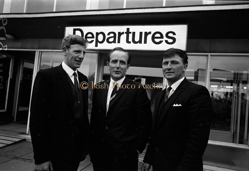 16/07/1967<br /> 07/16/1967<br /> 16 July 1967<br /> Fishermen leave on market research visit to Britain from Dublin Airport. Representatives from Killybegs, Dingle; Kilmore Quay and Castletownbere went on the trip to Fleetwood and Grimsby. Image shows Mr T.F. Geoghegan (centre) Market Development Manager of BIM, chatting with Mr John Hayes, Chairman, Kilmore Quay Fishermen's Co-operative Society and Mr John Power, Secretary, Kilmore Quay Fishermen's Co-operative Society at Dublin Airport prior to their departure for England.