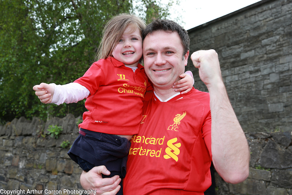 14/5/14 Fans Mark Fox, Newbridge and daughter Aoife, age 4 on their way to see the friendly game between Liverpool FC and Shamrock Rovers at the Aviva stadium in Dublin. Picture:Arthur Carron