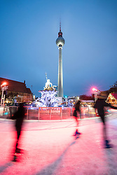 Ice rink at traditional Christmas Market at Alexanderplatz in Mitte Berlin Germany 2016