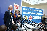 17 JAN 2002, BERLIN/GERMANY:<br /> Edmund Stoiber, CSU, Ministerpraesident Bayern und CDU/CSU Spitzenkandidat, und Angela Merkel, CDU Bundesvorsitzende, waehrend einem Pressestatement zu einer vorangegangenen Besprechung ueber die Organisation des Bundestagswahlkampfes, CDU Bundesgeschaeftsstelle<br /> IMAGE: 20020117-01-024<br /> KEYWORDS: Ministerpräsident, Mikrofon, microphone, Pressekonferenz