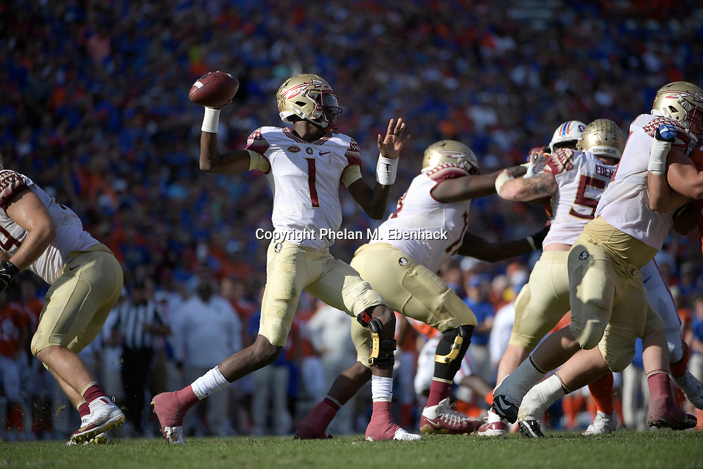 Florida State quarterback James Blackman (1) sets up to throw a pass during the second half of an NCAA college football game against Florida Saturday, Nov. 25, 2017, in Gainesville, Fla. FSU won 38-22. (Photo by Phelan M. Ebenhack)