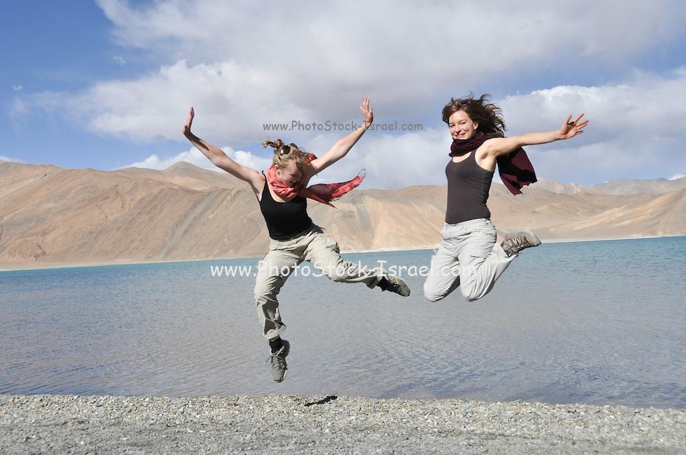 Young European tourists on the shores of Pangong Tso (Pangong lake), India, Jammu and Kashmir, Ladakh