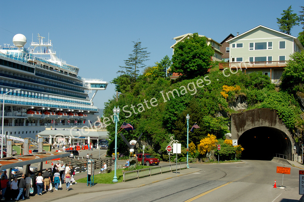 A cruise ship sitting at the main pier along Front Street near the tunnel.