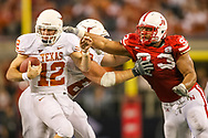 Ndamukong Suh sacks Colt McCoy for one of his 4.5 sacks in a 13-12 loss in the Big 12 Championship in Arlington, Texas on Dec. 5, 2009. © Aaron Babcock