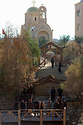 "Israel, Jordan River, Near Jericho, Qasr al Yahud. The Greek Orthodox Church on the Jordanian side of the river January 18th 2008. Epiphany, the day of Jesus' baptism, when ""the heavens opened, and he saw the spirit of God descending like a dove and lighting on him."" Celebrated in January by the Greek Orthodox Church. The holy day transforms the area as thousands of pilgrims flock to what is one of the most sacred and least visited places in Israel."