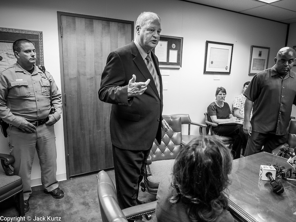 21 OCTOBER 2013 - PHOENIX, AZ:  Arizona Attorney General TOM HORNE walks into a meeting with DREAM Act protesters. The DREAMers are protesting the decision by Attorney General Horne to sue the Maricopa County Community College District to force the district to charge in-state tuition to the young people who qualify for the federal government deferred-action program.   PHOTO BY JACK KURTZ