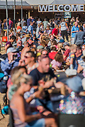 Eating in the sun in the Arena - The 2018 Latitude Festival, Henham Park. Suffolk 13 July 2018