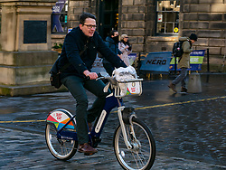 City Chambers, Edinburgh, Scotland, United Kingdom, Just Eat E-bikes: A new fleet of 163 rentable e-bikes are launched and integrated into the capital's existing cycle hire scheme by Just Eat Cycles. Edinburgh will now have the largest docked e-bike fleet in UK. Pictured: Edinburgh Sketcher aka Mark Kirkham, is a regular user of Just Eat bikes.<br /> Sally Anderson | EdinburghElitemedia.co.uk