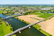 Nederland, Noord-Brabant, Den Bosch, 13-05-2019;  Fort Crèvecoeur, de  Maas in oostelijke richting. Wegbrug Treurenbrug (achtergrond) en de spoorbrug over de Maas tussen Hedel en Crevecoeur. Er wordt gewerkt aan weerdverlaging omgeving Fort Crèvecoeur, maakt onderdeel uit van het Maasoeverpark. Landschapspark in wording met ruimte voor de natuur, voor de landbouw  én waterberging.<br /> Fort Crèvecoeur, the Maas in an easterly direction. Treurenbrug and the railway bridge over the Maas between Hedel and Crevecoeur. Work is underway to reduce the floodplains around Fort Crèvecoeur, part of the Maasoever Park. Landscape park in the making with room for nature, agriculture and water storage.<br /> <br /> aerial photo (additional fee required); luchtfoto (toeslag op standard tarieven); copyright foto/photo Siebe Swart