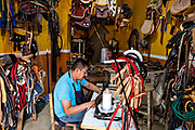 A saddler handcrafts saddles at his leather shop in Santiago Tuxtla, Veracruz, Mexico.