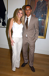 Footballer THEO WALCOTT and MELANIE SLADE at the opening of an exhibition entitled Exceptional Youth supported by Teen Vogue at the National Portrait Gallery, London on 3rd November 2006.<br /><br />NON EXCLUSIVE - WORLD RIGHTS