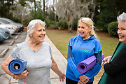 Senior woman socializing before or after a exercise class.