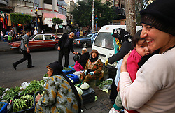 Bedouin women sell vegetables and spices on the side of the street in the mixed Shia and Sunni Muslim neighborhood of Tariq Jadida, in Beirut, Lebanon, March 23, 2006.
