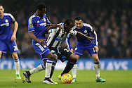 Seydou Doumbia of Newcastle United is challenged by Baba Rahman of Chelsea. Barclays Premier league match, Chelsea v Newcastle Utd at Stamford Bridge in London on Saturday 13th February 2016.<br /> pic by John Patrick Fletcher, Andrew Orchard sports photography.