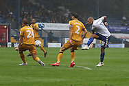 James Vaughan of Bury ® shoots at goal but sees his effort blocked. EFL Skybet football league one match, Bury v Port Vale at Gigg Lane in Bury ,Lancs on Saturday 3rd September 2016.<br /> pic by Chris Stading, Andrew Orchard sports photography.