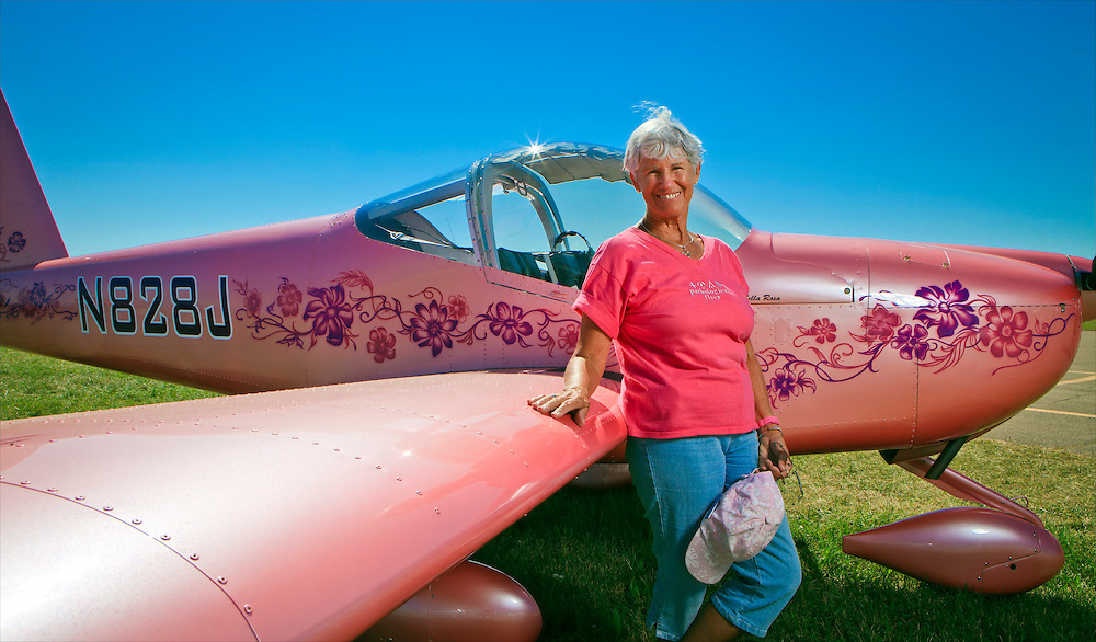 Judie Betz, owner and pilot of this RV-12. AirVenture 2011, Oshkosh, Wisconsin.  Created for General Aviation News.