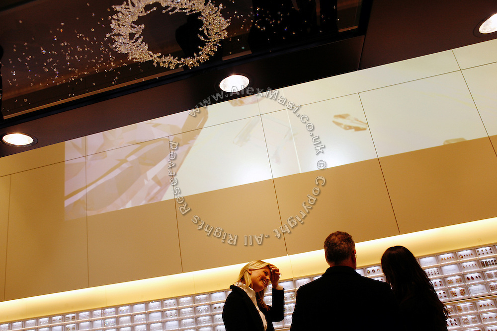 Jewels and clothes embroidered with crystals are on show during the new Swarovski shop preview on Thursday, Jan. 17, 2008, in London, England. The shop, featuring outstanding design by architect Tokujin Yoshioka, will officially open tomorrow, Jan. 18, 2008. For the first time, Swarovski is making its raw crystal elements available to buy on the high street, opening the doors to a new creative universe. This Crystallized Cosmos & Lounge store also offers the widest possible selection of additional creative elements including wood, semi-precious, metal and many other jewellery components. The in-store atelier provides two specially created services ? a design studio and personal stylist.  ** Italy Out**..