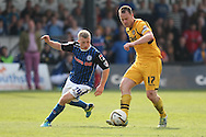 Mike Flynn of Newport passes the ball around Jamie Allen of Rochdale. Skybet football league two match, Newport county v Rochdale at Rodney Parade in Newport, South Wales on Saturday 3rd May 2014.<br /> pic by Mark Hawkins, Andrew Orchard sports photography.