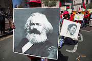 Karl Marx poster. Demonstration by unions and other organisations of workers to mark the annual May Day or Labour Day. Groups from all nationalities from around the World, living in London gathered to march to a rally in central London, UK.