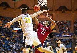 Nov 28, 2018; Morgantown, WV, USA; Rider Broncs forward Frederick Scott (13) shoots in the lane guarded by West Virginia Mountaineers forward Logan Routt (31) during the first half at WVU Coliseum. Mandatory Credit: Ben Queen-USA TODAY Sports