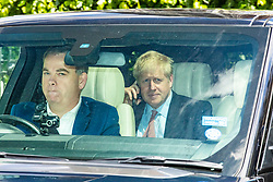 © Licensed to London News Pictures. 17/06/2019. London, UK. Boris Johnson (R) leaves Parliament by car after other candidates for the leadership of the Conservative party appeared at a hustings before lobby journalists. A second round of voting on the new leader will take place tomorrow. Photo credit: Rob Pinney/LNP