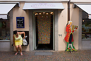 "Advertising 'Mozartkugeln' is a life-size cut-out of Austrian composer Wolfgang Amadeus Mozart outside a shop in the Italian border town of Brixen-Bressanone in South Tyrol but near the Austrian Brenner Pass. A Mozartkugel or 'Mozart ball' is a small, round confectionary made of marzipan, nougat and dark chocolate. It was originally known as the ""Mozartbonbon"", and was created by Salzburg confectioner Paul Fürst in 1890."