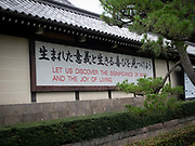 Sayings on the outside wall of the Higashi Honganji Temple, Kyoto, Japan