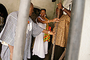 Leader of the House of Lords Baroness Valerie Amos holds an iron bar used in a dungeon cell as she visits the former slave fort of Elmina Castle in Elmina, Ghana, on Sunday Mar 4, 2007. Amos was visiting on the occasion of the 200th anniversary of the abolition of slave trade, which coincides with Ghana's 50th anniversary of independence.