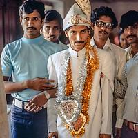 A groom waits for his bride at a traditional Bengali wedding in Dhaka, Bangladesh.