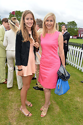 Left to right, NATASHA MOUFARRIGE and her mother TANIA BRYER at the Cartier Queen's Cup Final polo held at Guards Polo Club, Smith's Lawn, Windsor Great Park, Egham, Surrey on 15th June 2014.