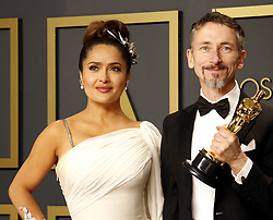 Salma Hayek and Mark Taylor at the 92nd Academy Awards - Press Room held at the Dolby Theatre in Hollywood, USA on February 9, 2020.