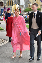 Pixie Geldof and George Barnett arrive at the grounds of Windsor Castle during the wedding of Princess Eugenie to Jack Brooksbank at St George's Chapel in Windsor Castle.