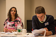 Purchase, NY – 31 October 2014. Yonkers High School student Geri Shentoli (right) checking the case notes. The Business Skills Olympics was founded by the African American Men of Westchester, is sponsored and facilitated by Morgan Stanley, and is open to high school teams in Westchester County.