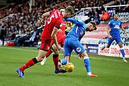 Peterborough United forward Matt Godden (9) and Walsall defender Jon Guthrie (5) during the EFL Sky Bet League 1 match between Peterborough United and Walsall at London Road, Peterborough, England on 22 December 2018.
