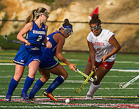Winnisquam's #2/Atherton and Laconia's #9/Setzer go for the ball during NHIAA Division III Field Hockey Friday afternoon.  (Karen Bobotas/for the Laconia Daily Sun)