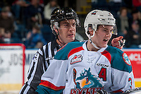 KELOWNA, CANADA - DECEMBER 30: Linesman, Kevin Crowell, makes a call against the Victoria Royals from behind Riley Stadel #3 of the Kelowna Rockets on December 30, 2016 at Prospera Place in Kelowna, British Columbia, Canada.  (Photo by Marissa Baecker/Shoot the Breeze)  *** Local Caption ***