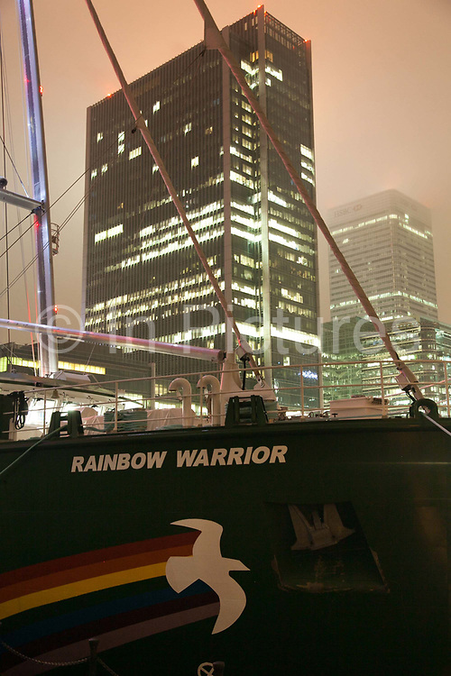 Rainbow Warrior lll docked in West India Docks. The Rainbow Warrior ll is the third generation of the legendary Greenpeace ship Rainbow Warrior. The first was bombed and sunk by French special agents, second one is now serving as a hospital ship in the Bengal Bay and this, the third in line is build according to the highest green environmental specs. The ship is now on it's maiden voyage  around the globe heading from London to Sweden. The Docklands were once used as a port of entry to London. Now, a major part of London's financial district is based in the Canary Wharf on the peninsula.